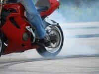 1301095_motorcycle_stunter_tyre_burnout_-sxchu-thumb-225x150-425741